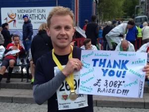 Fundraiser Alex at the finish of Midnight Sun Marathon in Tromso Norway